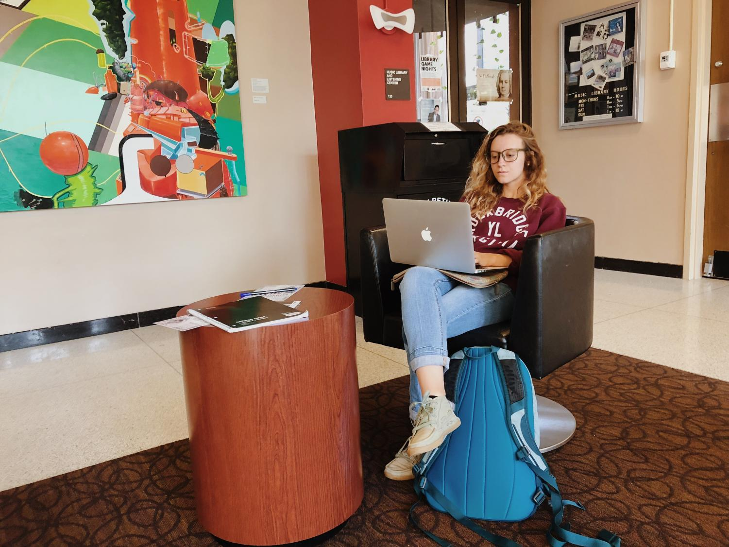 Ariel Williams, junior at Miami University, finishes homework at the Amos Music Library.