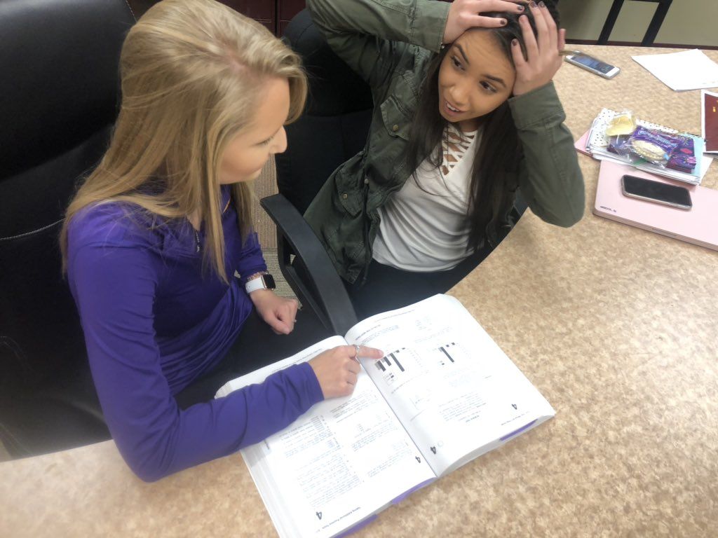 Senior Larissa Frey tries her best to help fellow senior Courtney Schneider practice for the ACT.