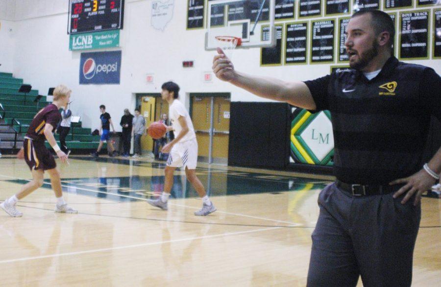 Head+Coach+David+Lane+directs+the+defense+against+SWOC+rival+LIttle+Miami.+