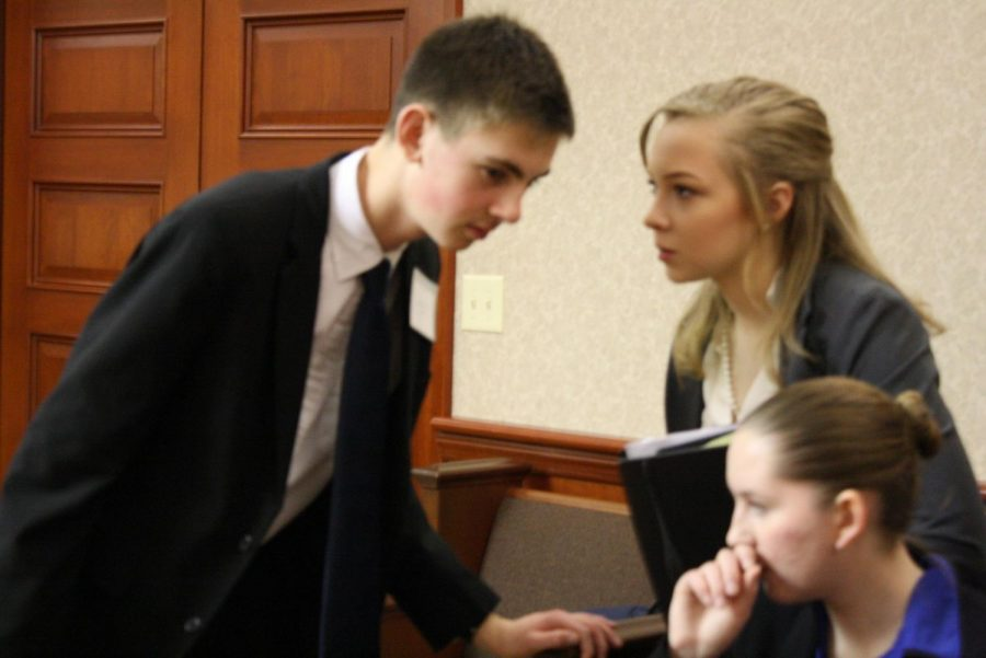 Defense+Attorney+Lainy+Demeropolis+advises+Prosecution+Attorney+Levi+Grimm+before+the+District+competition+at+Butler+County+Courthouse.+