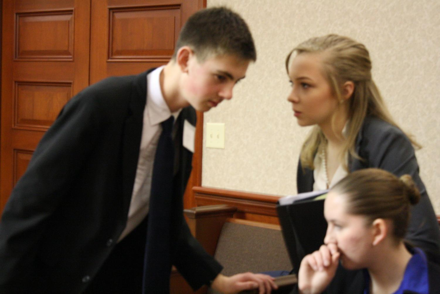 Defense Attorney Lainy Demeropolis advises Prosecution Attorney Levi Grimm before the District competition at Butler County Courthouse.