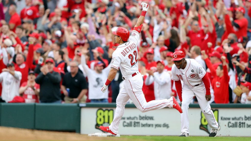 Derek Dietrich celebrates a go ahead 3 run home run on opening day against the Pittsburgh Pirates.