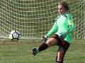 Sophomore Lauren Uhl playing goalkeeper at her Cincinnati West soccer game.