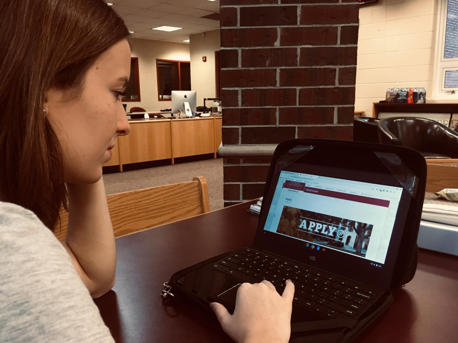 Senior Megan Foster researches the application requirements for a local university.
