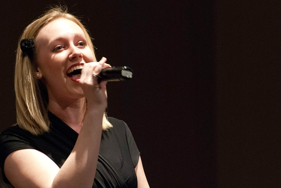 Sarah Grace McCollough sings at her choir concert at Cincinnati Christian University.