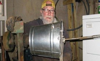 My Grandpa working on plumbing in his basement before his diagnosis