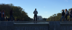 A man stands alone at the Reflecting Pool in Washington D.C..