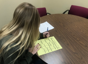 A student fills out their course option sheet for the upcoming 2020-2021 school year.