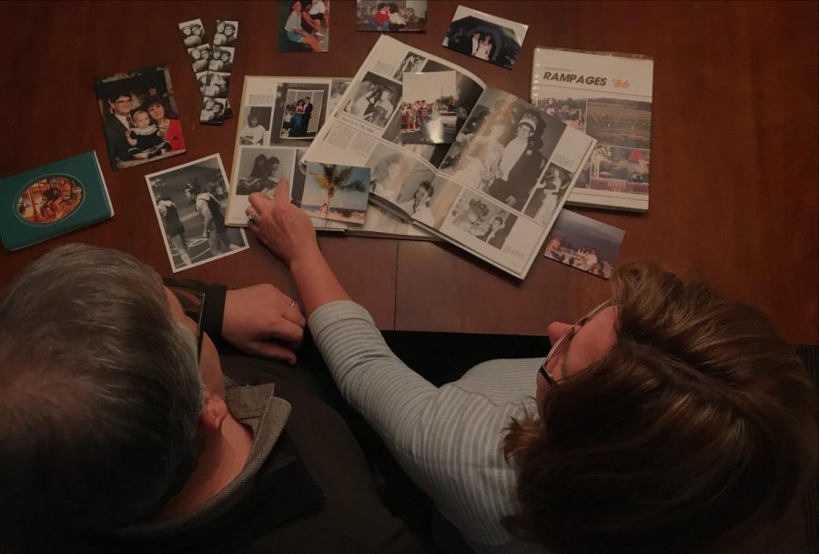 Roger+and+Lori+Dunn+reflect+back+on+the+memories+they%27ve+made+together+by+looking+through+old+photographs+and+yearbooks.