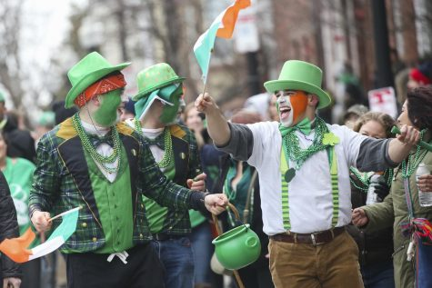 People celebrate at the 118th St. Patrick