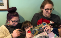 Three best friends (Carolyn Meyers, RHS graduate, Abbie Webster, junior, and Victoria Arno, junior) enjoy their Nintendo Switches  while waiting for Animal Crossing: New Horizons to release.