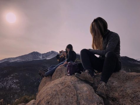 On a hike in the mountains of Colorado, the group takes a moment to admire the scenery and fresh air.