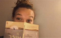 Here is me holding my book nook, Of Mice and Men.