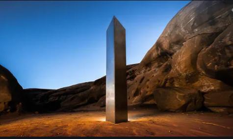 The Utah monolith standing tall in the desert.