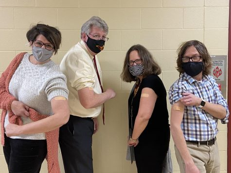 RHS faculty show off their bandaids after receiving their first dose of the COVID-19 vaccine.