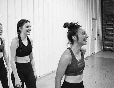 Dance students Estella Varner and Mary Southwick share a laugh during rehearsal.