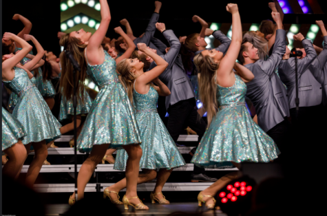 Ross' show choir, Legacy performs on the RHS stage at the end of a long day hosting other schools at their very own competition.