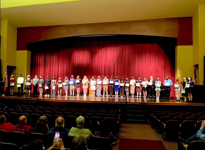 All inducted Tri-M members lined up with their certificates