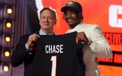 Wide receiver Ja'Marr Chase holds his new jersey after being drafted fifth in the 2021 NFL draft.