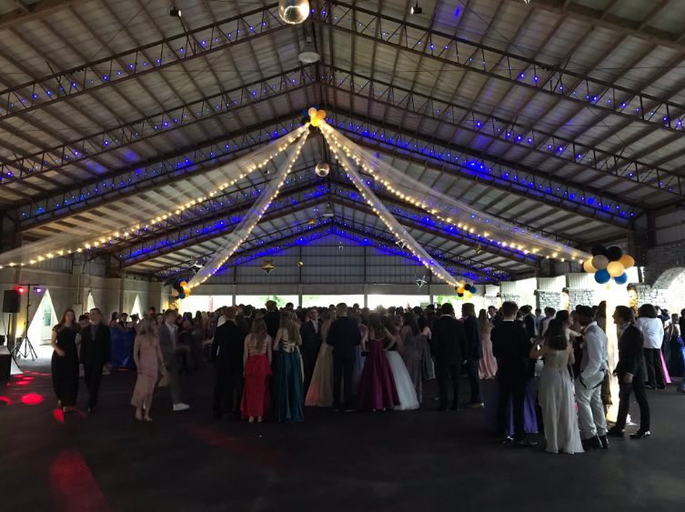 Students dance under the lights at prom.