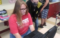Seniors Kathy Reynold and Jesse Gabbard  watching Puce Moment during free time in class.