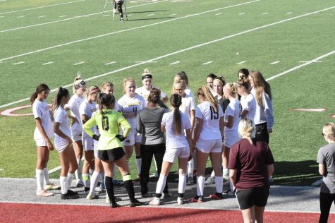 Head Girls Soccer Coach Jessica Buehner giving a pre-game speech before the Princeton game.