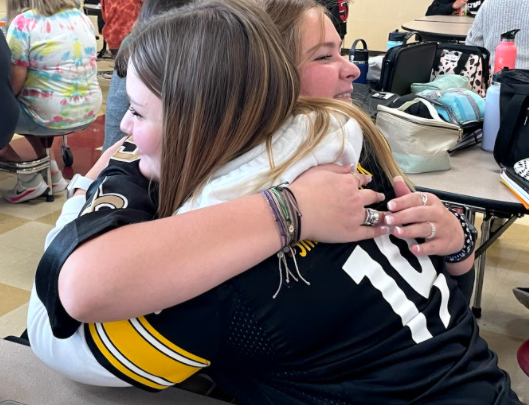 Taylor Willsey and Lydia Trout hugging it out after discussing their feelings and choosing to forgive one another.