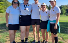 The girls varsity golf team poses after coming second in SWOC and setting an all-time low team score of 18 holes.